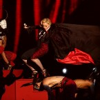 Madonna stumbles whilst performing on stage as her cape is pulled during the 2015 Brit Awards at the O2 Arena, London.<span class=