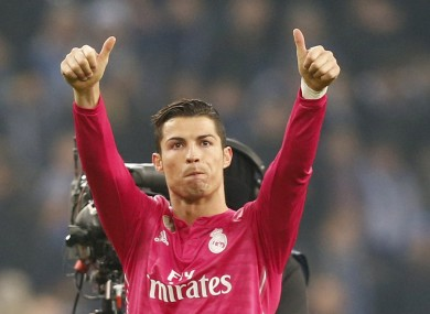Ronaldo salutes travelling Real Madrid fans.