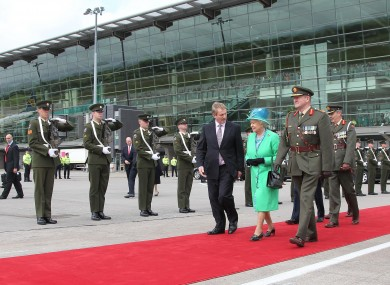 Taoseach Enda Kenny walking alongside the Queen at Cork Airport