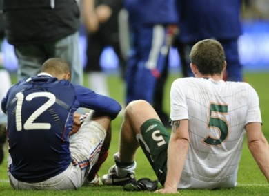 Henry with a devastated Richard Dunne.