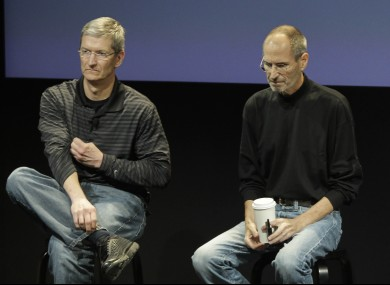 Apple's Tim Cook, left, and Steve Jobs, in 2010.