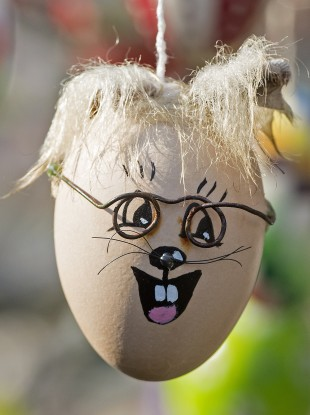 A decorated egg hangs on an apple tree with abut 10,000 painted Easter eggs in the garden of retired couple Christa and Volker Kraft in Saalfeld, central Germany
