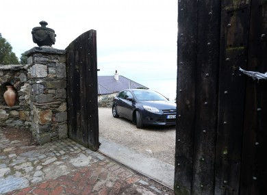 The gates opening at Gorse Hill as Brian O'Donnell leaves for court.