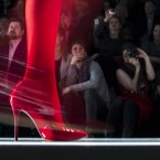 Spectators watch as a model displays a creation by Russian designer Slava Zaitsev during Fashion Week, in Moscow. (AP Photo/Pavel Golovkin)<span class=