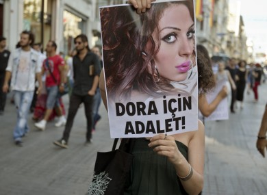 Protester with photo of Dora Oezer, a transsexual Turkish woman who was killed in 2013. (File)