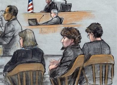 Assistant U.S. Attorney Aloke Chakravarty, left, is depicted addressing the jury as defendant Dzhokhar Tsarnaev, second from right, sits between his defense attorneys during closing arguments.