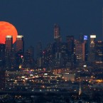A full moon is seen as it rises over the New York City skyline seen from West Orange, New Jersey. <span class=