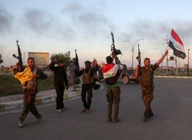 Iraqi security forces and allied Shiite militiamen celebrate in central Tikrit after Islamic State troops were driven out the city late last month.