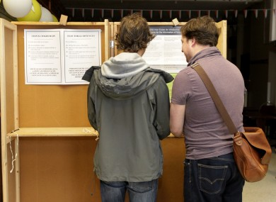 Voting for the Referendums on Marriage Equality and Age of Eligibility to the Office of President are Andrew McCullagh, left, and his partner Oisin O'Reilly,