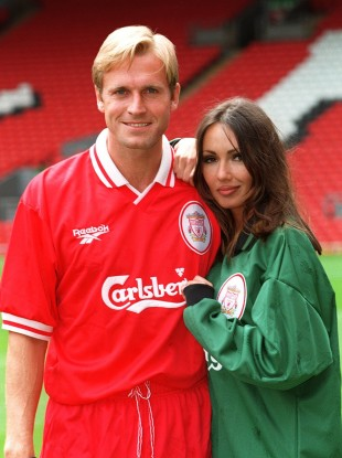 John Scales poses with Page 3 girl Kathy Lloyd to model Liverpool's new Reebok kit in 1996.