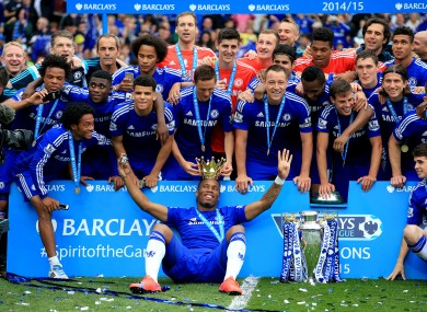 Chelsea's Didier Drogba celebrates with the trophy.