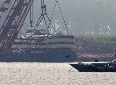 Medical workers prepare to get into the capsized Eastern Star ship after being lifted by cranes on the Yangtze River