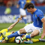 Andrea Belotti of Italy and Sweden's Alexander Milosevic both go into a full-blooded challenge at the U21 European Championships.<span class=