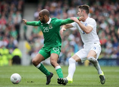 Ireland's David McGoldrick and Gary Cahill of England compete for the ball.
