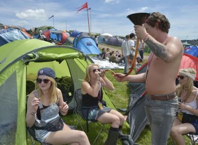 Festival-goes get in the swing of things as Glastonbury kicks-off in Somerset.