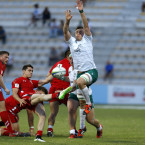 Alex Thompson of Ireland tries to block down Tomos Williams' box-kick in World Rugby U20 Championship.<span class=