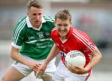 Cork's John McLoughlin up against Limerick's Michael Lyons.
