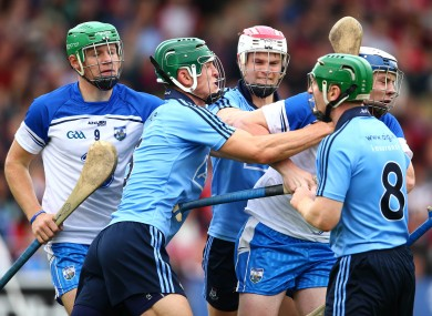 Down and out: Chris Crummey clashes with Shane Bennett as Dublin crash out of the championship.