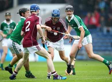 Galway and Limerick players battle it out for possession.