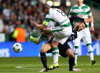 Scott Brown goes into the tackle with typical aggression.