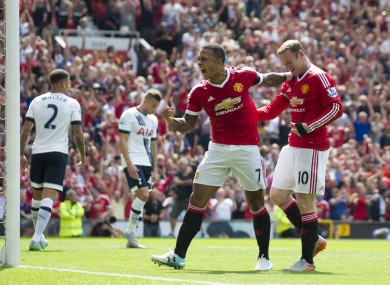 Manchester United's Wayne Rooney, right, celebrates with teammate Memphis Depay after an own goal by Tottenham's Kyle Walker.