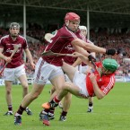 Man-of-the-Match Johnny Glynn sends Cork's Johnny Glynn flying, as Galway won the other quarter-final.