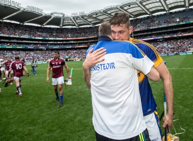 Eamon O'Shea and Seamus Callanan bid farewell to each other.