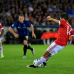 Javier Hernandez slips up just as he hits a penalty during the Champions League qualifier in Bruges,