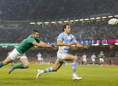 Argentina's Juan Imhoff, right, races clear of Ireland's Rob Kearney to touch the ball down for a try.
