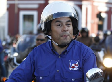 Morales rides his motorcycle prior to a campaign rally earlier this month.