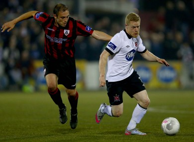 Longford's Stephen Rice with Daryl Horgan of Dundalk.