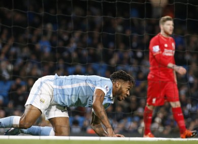Manchester City's Raheem Sterling gets up from the back of the net after falling over attempting a shot on goal