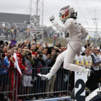 Leapin' Lewis! Hamilton celebrates after winning the F1 Drivers Championship.<span class=