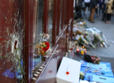 Tributes are left at the La Carillon restaurant in Paris, following the attacks in the French capital.