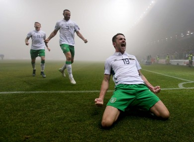 Brady celebrates his goal in front of travelling Irish fans.
