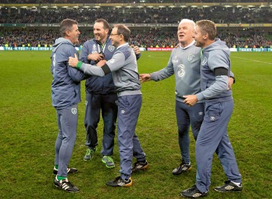 Ireland's management team embrace at the full-time whistle.