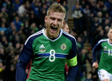 Steven Davis celebrates the winner against Latvia