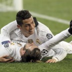 Back on top! Cristiano Ronaldo and Gareth Bale celebrate during Real Madrid's win over FC Shakhtar.<span class=