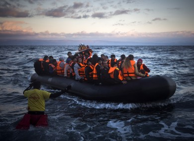 Refugees and migrants arriving on the Greek island of Lesbos yesterday