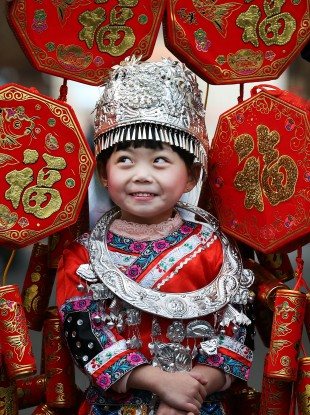 Linjia Zheng (5) helps launch the Chinese New Year Festival earlier this month.