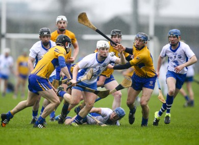 Waterford's Andy Molumby surrounded by Clare defenders in Carriganore today.