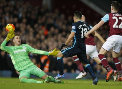 Manchester City's Sergio Aguero, scores his second goal of the game.