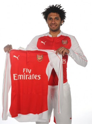 Elneney in Arsenal's red and white.
