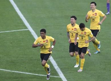 Guangzhou Evergrande''s Paulinho of Brazil (8) celebrates with teammates after scoring a goal.