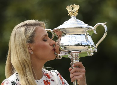 Angelique Kerber kisses her Australian Open trophy the day after winning it.