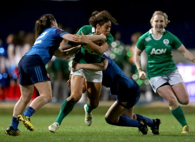 Ireland's Sene Naoupu tackled by France pair Elodie Poublan and Lucile Godiveau.
