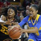 Arizona State's Elisha Davis, left, and UCLA's Jordin Canada battle for possession.<span class=