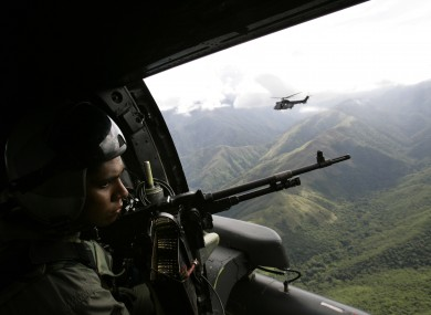 Venezuelan army helicopters fly over the Sierra de Perija national park, west of Caracas where poppy and marijuana plants are often discovered (2005).