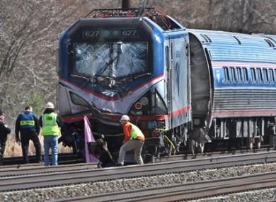 Amtrak investigators inspect the deadly train crash in Chester, Philadelphia.