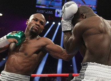 Floyd Mayweather lands a punch on Andre Berto